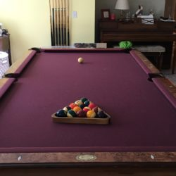 PRICE REDUCED- 8' Merriville pool table with cherry finish and letter pockets.